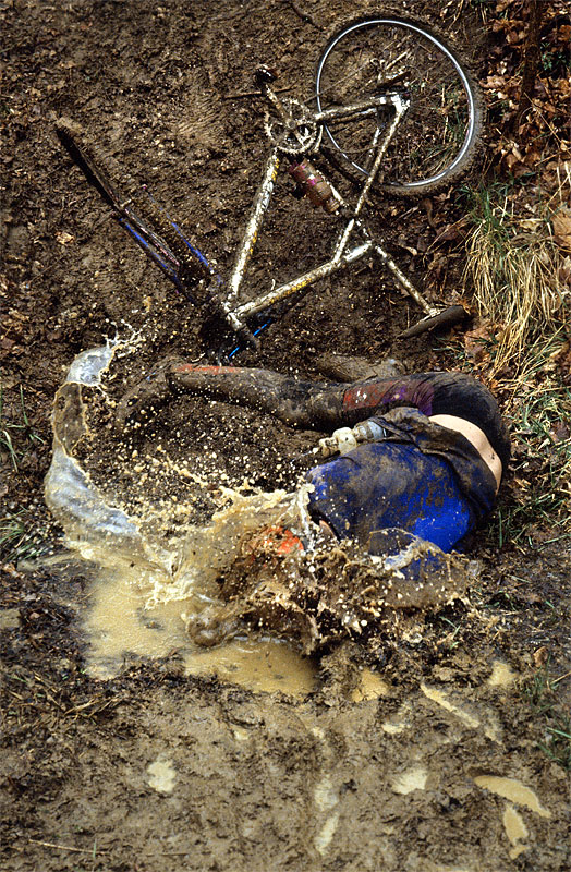 Chris Chrisman plunges head first into a small stream during his final trip around the course of the Mudfest mountain bike race in Carrollton, Ky. Chrisman was uninjured but remarked, still dazed from the fall, {quote}The water's cold.{quote}