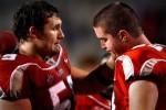 New Mexico's Robert Turner, left, consoles Erik Cook in the closing seconds of the Lobo's 21-27 loss to TCU at University Stadium on Nov. 11, 2006.