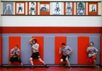 Underneath pictures of former Rio Grande High School state champion wrestlers, 2007 teammates, left to right, Charles Gallegos, Justin Vigil, David Romero and Fabion Griego, work to perfect their escape moves.
