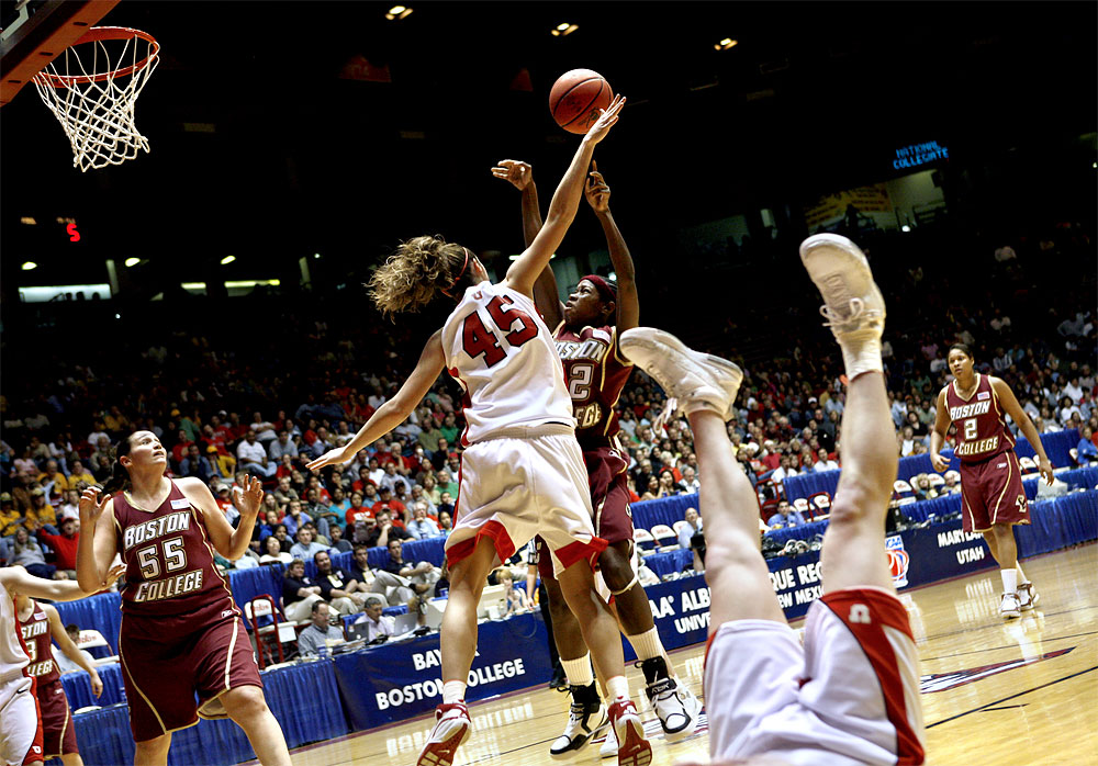 Boston College's Brittanny Johnson, center, has a shot blocked by Utah's Jessica Perry. Kim Smith of Utah, foreground, was turned upside down during the play. Utah won the third round 2006 NCAA tournament game at The Pit 57-54.