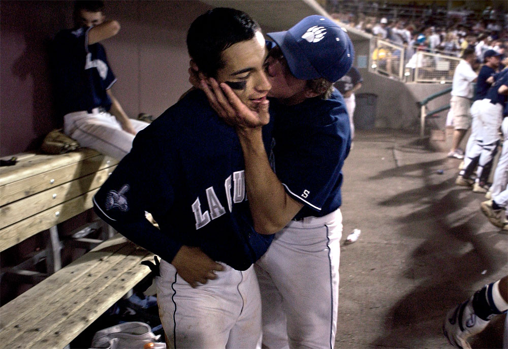La Cueva High School's Adrian Aranda gets a kiss from teammate Bryan Pullen after hitting a two run double that secured the state championship semi-final game. The game, against Las Cruces, ended 4-2 in the 8th inning.