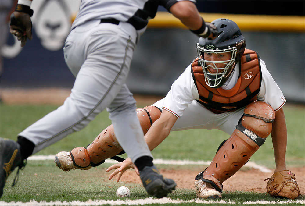 Eldorado catcher Brett Haggerty retrieves the baseball before tagging out Cibola's Andrew Arellanes who was attempting to score in the fourth inning. Eldorado won the game 6-4 too advance in the 2007 state tournament.