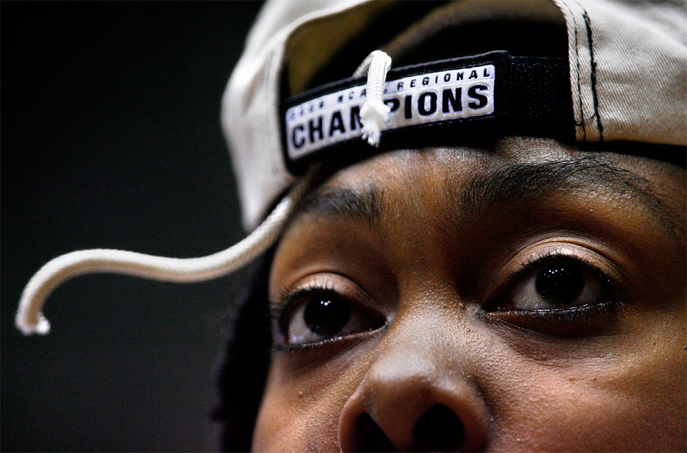 Maryland's Charmaine Carr keeps a souvenir piece of the net in a hat she received following her team's victory over Utah in the 2006 NCAA regional final in Albuquerque at the Pit.