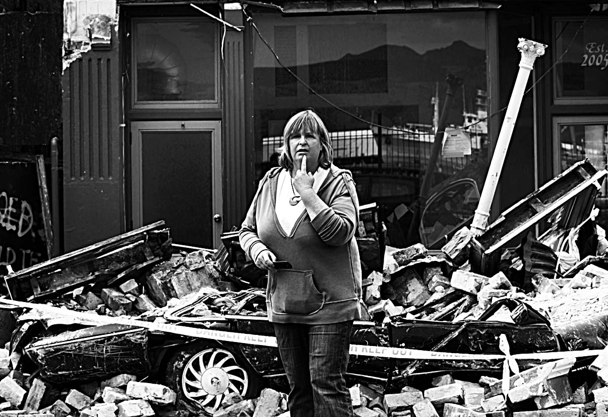 A woman looks in disbelief on the street in Lyttleton, New Zealand after a 6.3 magnitude earthquake rocked the city 22-2-11.  © Sam Mooy/The Australian