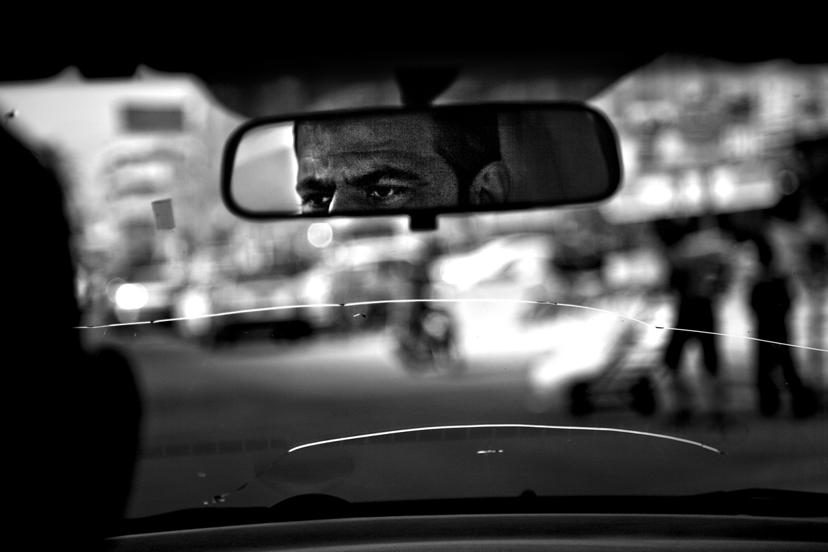 Driver Salam peers through his broken windscreen driving through the suburb of New Baghdad . As a driver for a prominent British newspaper he is considering his future as the economic  landscape  changes dramatically.  Iraq is preparing after US President Barack Obama has confirmed the end of all combat operations in the country by 31 August.Some 50,000 of 65,000 US troops currently in Iraq are set to remain until the end of 2011 to advise Iraqi forces and protect US interests.The remaining 50,000 troops will stay in the country in order to train Iraqi security forces, conduct counterterrorism operations and provide civilians with ongoing security, said Mr Obama.An agreement negotiated with the Iraqis in 2008 states that these troops must be gone from the country by the end of next year.