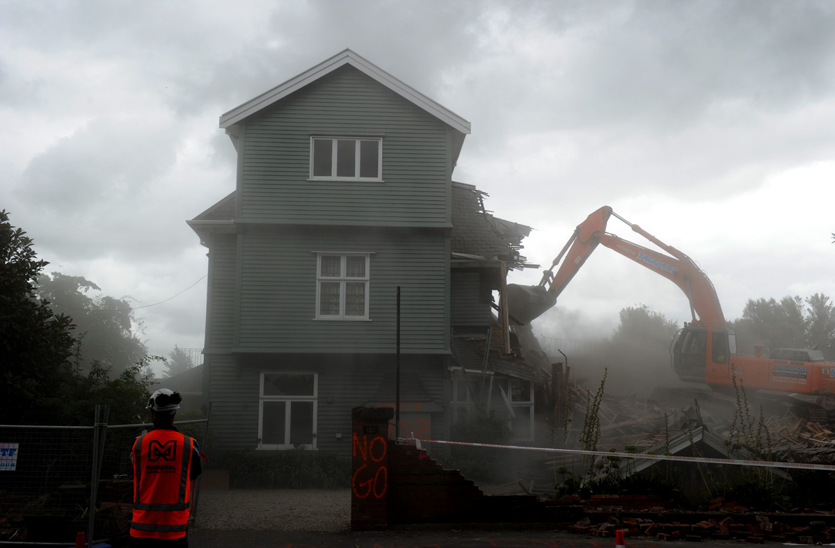 Quake damaged houses are demolished in Christchurch New Zealand. Christchurch was devastated by a 6.3 magnitude earth quake on the 22/02/2011.© Tracey Nearmy/AAP