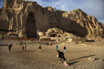 Images © Graham Crouch 2013Local kids play football in front of the empty Buddhas of Bamiyan niches, two 6th century monumental statues of standing buddha carved into the side of a cliff in the Bamyan valley in the Hazarajat region of central Afghanistan.The valley is home to many Hazara's, who have often made up vast numbers of refugees to Australia, having been persecuted and driven from their homes in both Afghanistan as well as from Quetta in Pakistan where a lot of displaced Hazara fled to during the Taliban years. Bamiyan is home to a lot of Hazara who are Shia muslim and as such are looked down upon by the Sunni Pashto tribes that make up the population majority in Afghanistan.