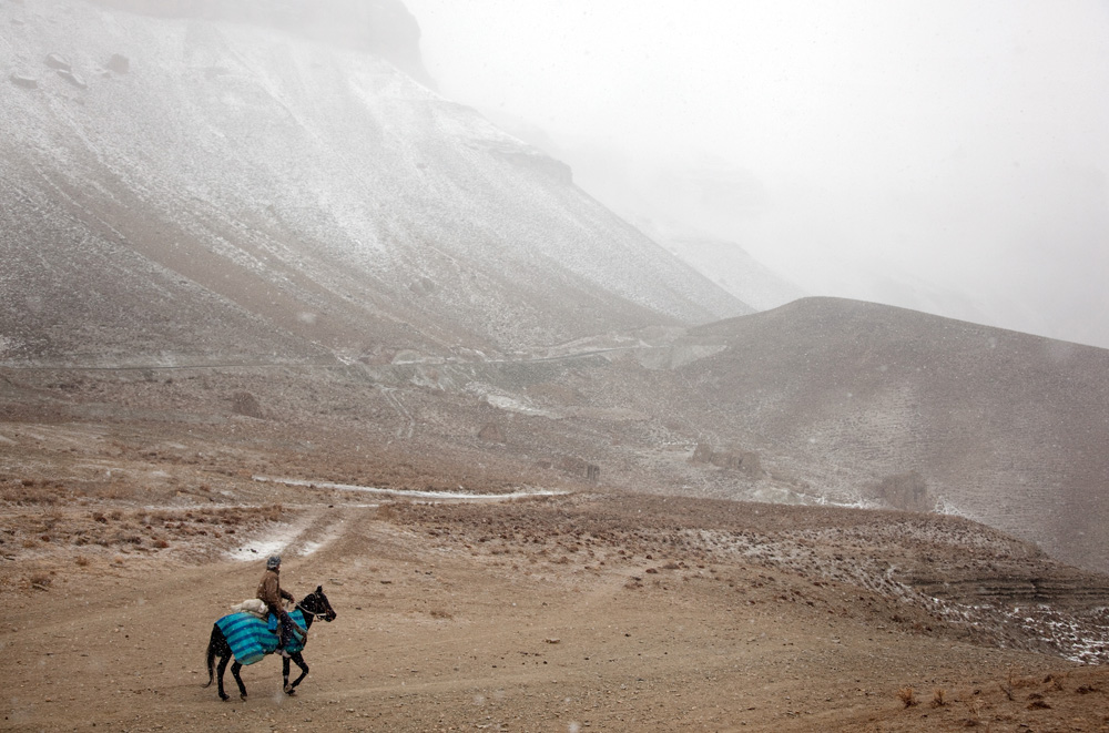 Images © Graham Crouch 2013A local Hazara man and his horse at Band-e-Amir national park  near Bamiyan home to the empty Buddhas of Bamiyan niches, two 6th century monumental statues of standing buddha carved into the side of a cliff in the Bamyan valley in the Hazarajat region of central Afghanistan.The valley is home to many Hazara's, who have often made up vast numbers of refugees to Australia, having been persecuted and driven from their homes in both Afghanistan as well as from Quetta in Pakistan where a lot of displaced Hazara fled to during the Taliban years. Bamiyan is home to a lot of Hazara who are Shia muslim and as such are looked down upon by the Sunni Pashto tribes that make up the population majority in Afghanistan.