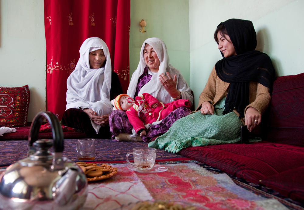 Images © Graham Crouch 2013 Sadiqa Nas (right) with her aunties Gulzewar and Mariam and neice Fatima at their family home in Kabul.  Ethnic Hazara's, who have often made up vast numbers of refugees to Australia, having been persecuted and driven from their homes in both Afghanistan as well as from Quetta in Pakistan where a lot of displaced Hazara fled to during the Taliban years. Hazara Shia muslims are looked down upon by the Sunni Pashto tribes that make up the population majority in Afghanistan.