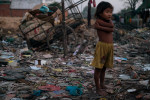 Rubbish dump child, Phnom Penh, Cambodia © Dan Himbrechts