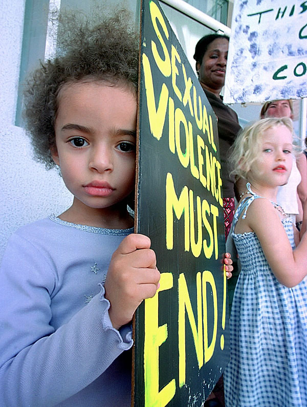 Children at a protest rally against sexual violence.Pic ©  Brian Cassey