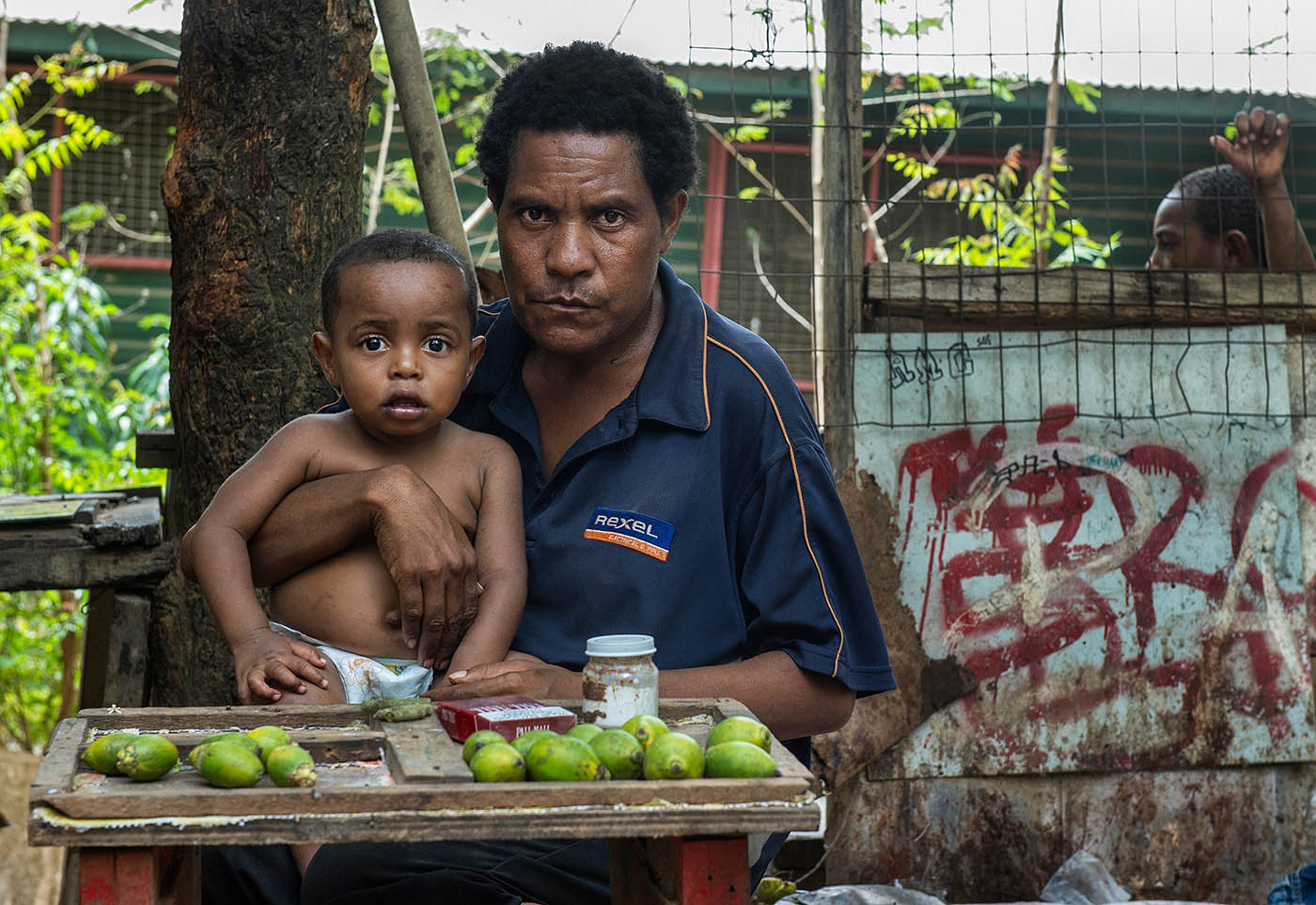 Betel nut seller Nancy Wala at Eight Mile with her child Teffynaya.  © Brian Cassey