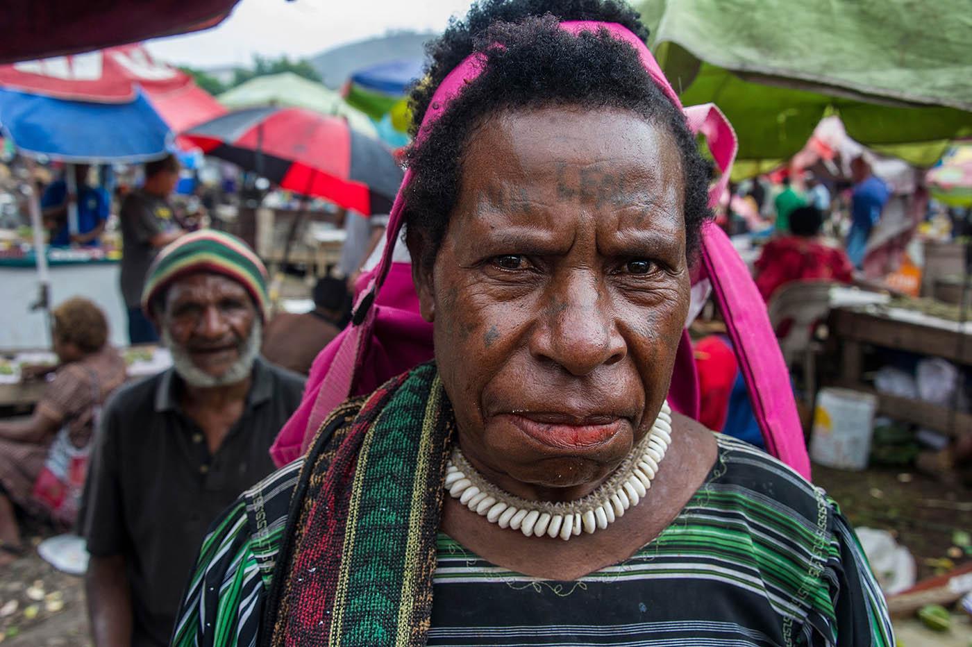 A betel nut customer at Hohola market, Port Moresby.  © Brian Cassey