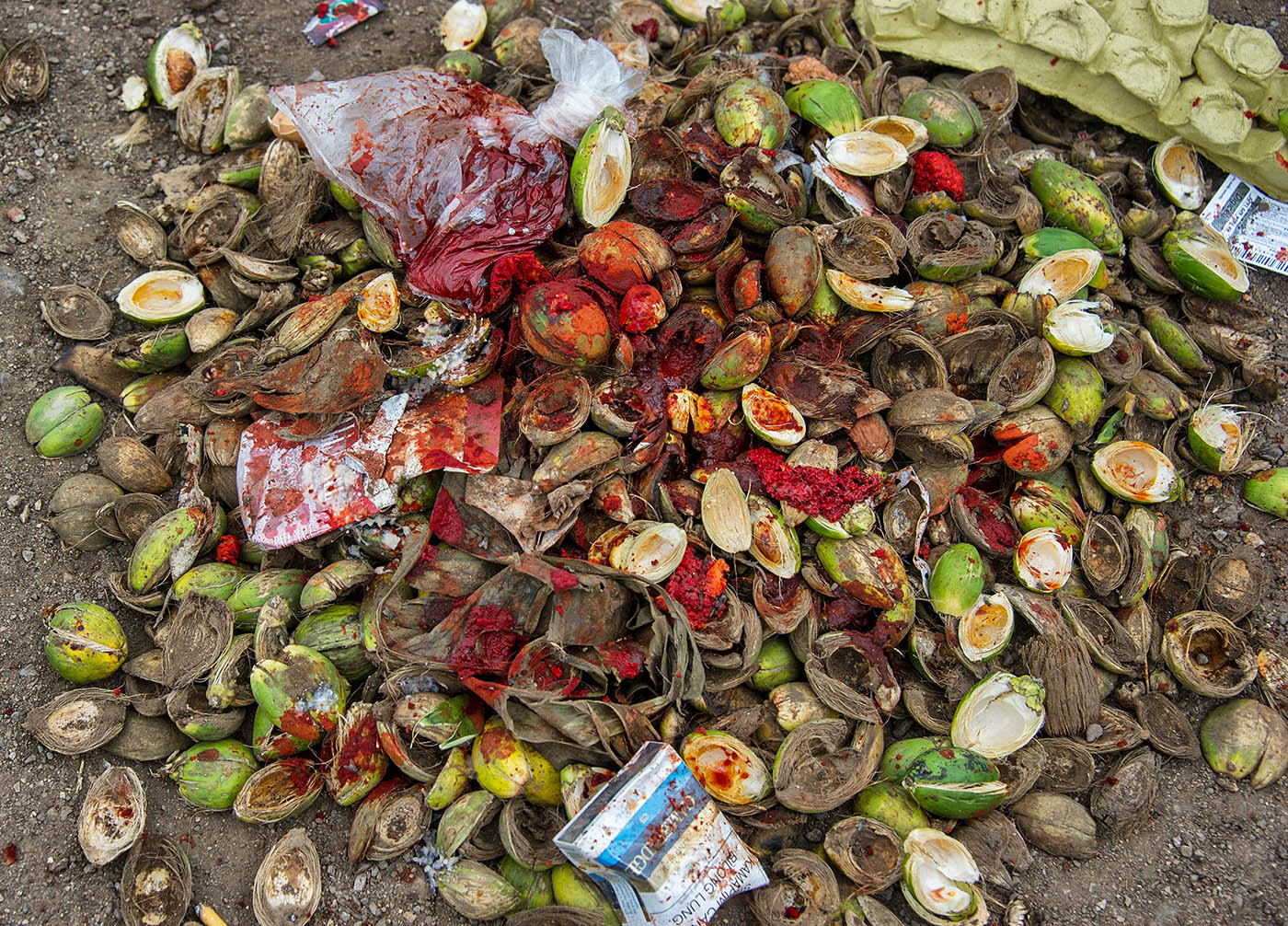 Betel nut husks, mustard flowers and spittle that has long been a feature of Port Moresby streets.  © Brian Cassey