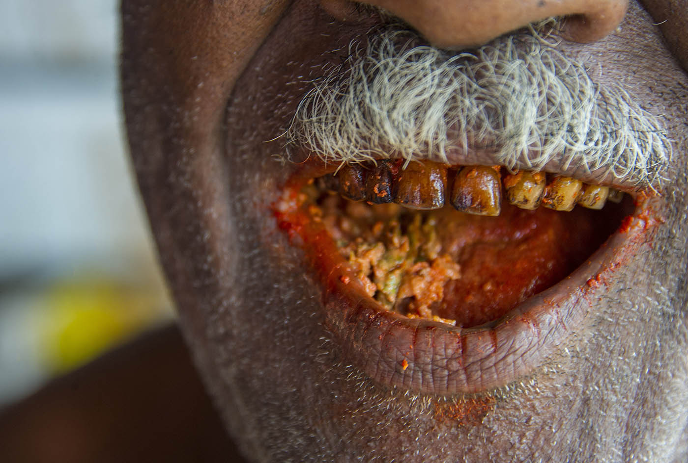 The result of chewing betel nut, mustard and lime.  © Brian Cassey