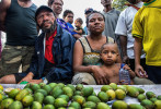 Betel nut seller Grace Moh with son Edward at Six Mile market.  © Brian Cassey