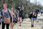Traumatised staff leave Dunk Island © Brian Cassey 2011