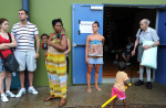 Stunned evacuees emerge from a Cyclone Shelter. © Brian Cassey