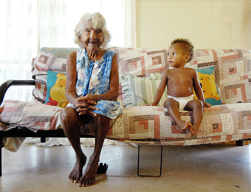 One year old Patrina Sands eyes her great great grand mother 87 year old Bessie Savo.Shot for a story on indigenous life expectancy rising for the first time.  © 2008 Brian Cassey