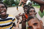 Children in the remote indigenous community of Aurukun gather in the main street to play the local game of 'sticks'.   © 2008 Brian Cassey