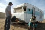 Norman and Mavis Wilde at their wrecked  caravan home in Urandangi. The community has no power, water or sanitation.   © 2008 Brian Cassey