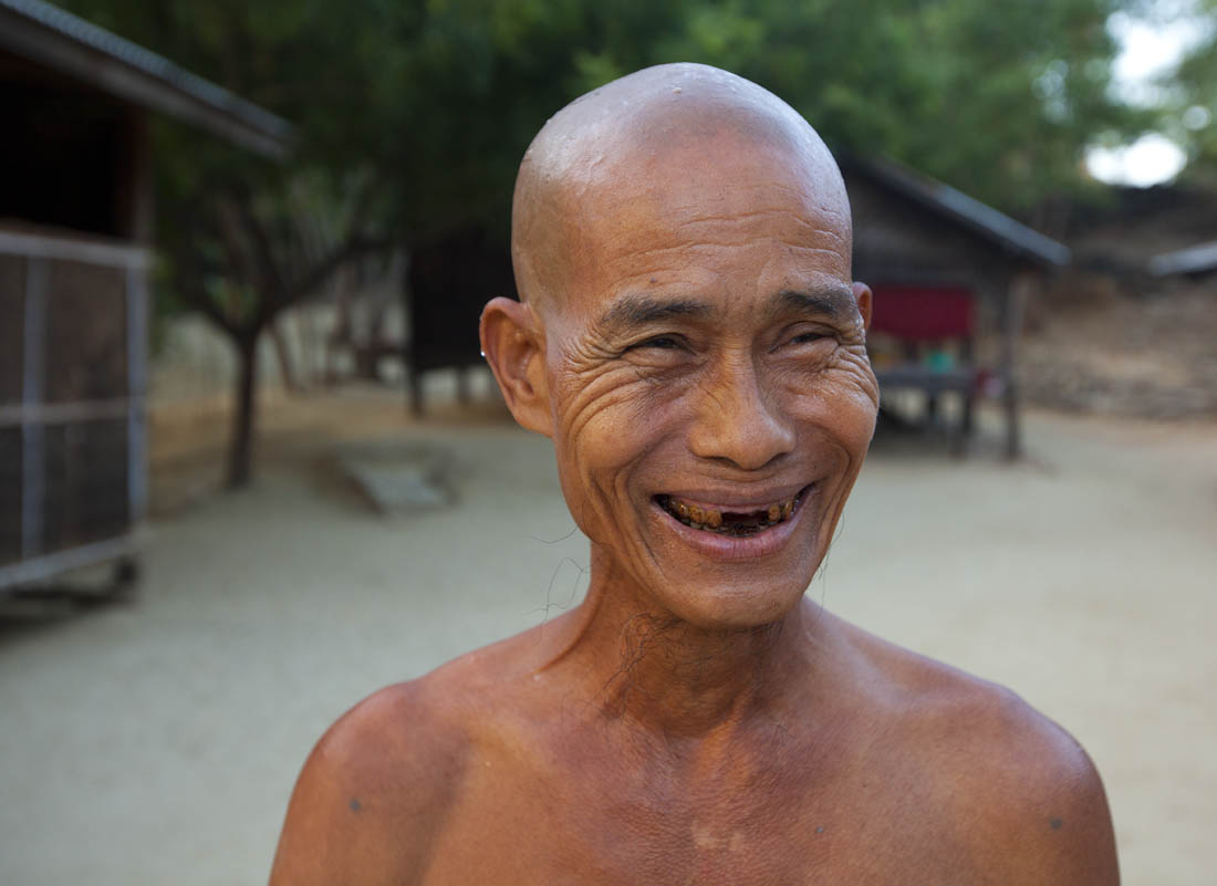 © MARK 'CRUSTY' BAKER - 12.11.2012 -  A monk smiles after having his head shaved by colleagues in Bagan, Myanmar.