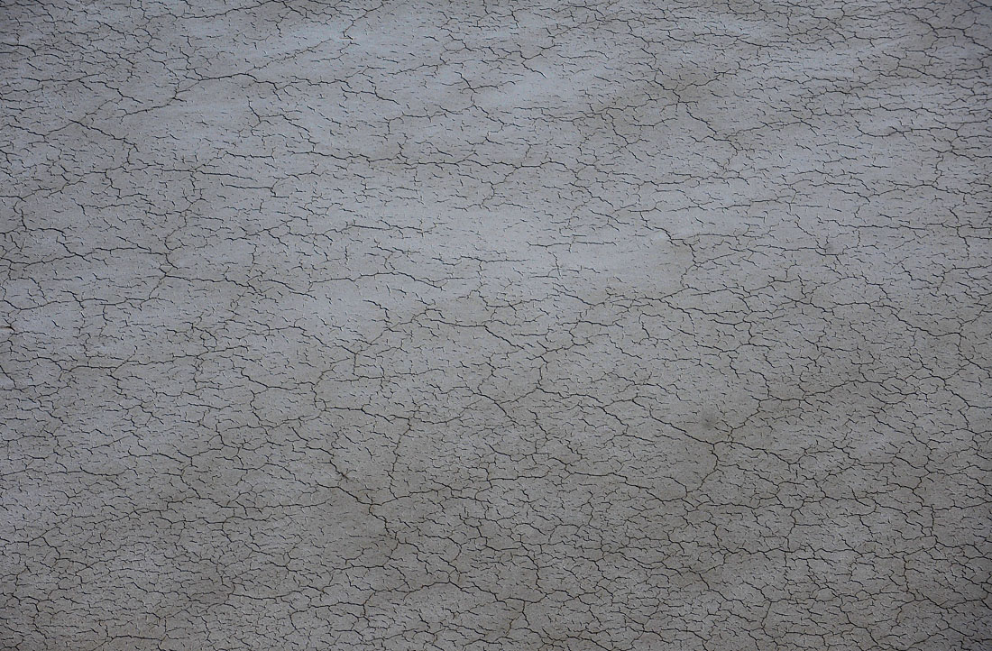 The cracked salt - pan floor of Lake Eyre where water is yet to reach at the southern end of Lake Eyre.© Dean Lewins/AAP Image 2010