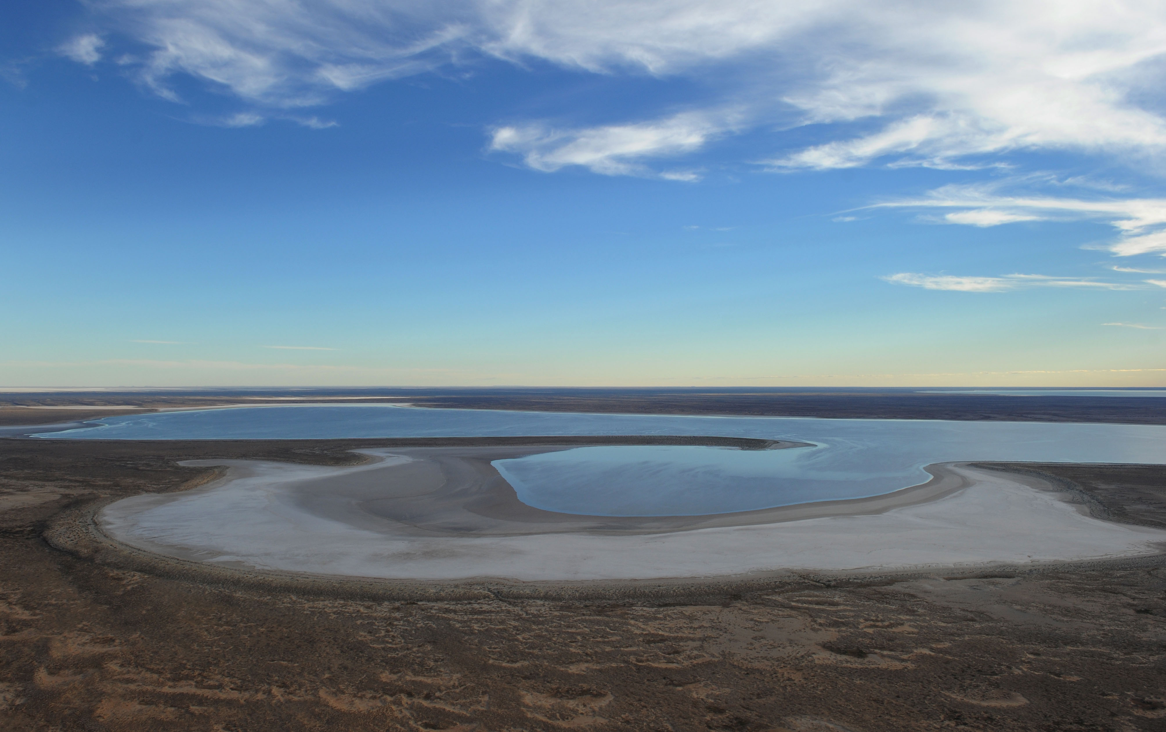 Water slowly begins to fill the  salt - pan floor of Lake Eyre at the southern end of the lake.© Dean Lewins/AAP Image 2010