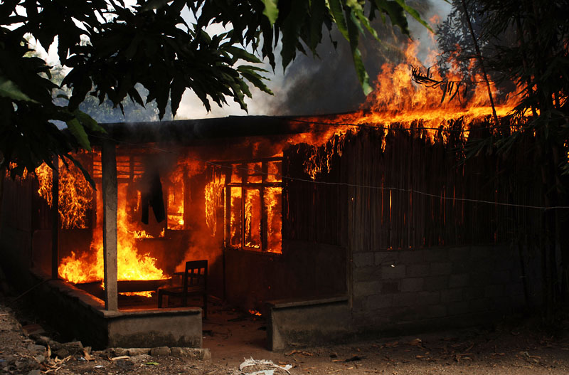 A house burns in the Becora district in the capital Dili.© 2006 Dean Lewins/AAPImage