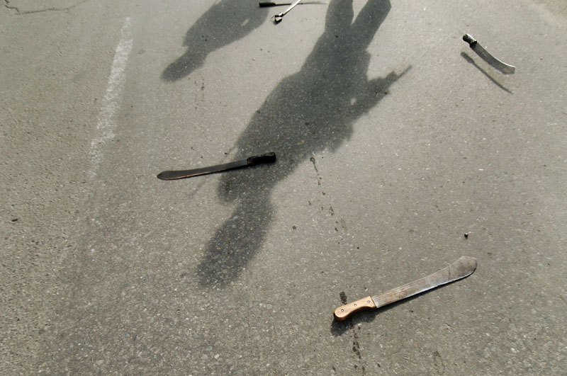 Machete's are thrown on to the road as Australian troops detain and disarm a gang of youths near the port area in the capital Dili© 2006 Dean Lewins/AAPImage