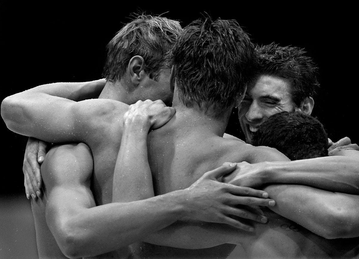 © DEAN LEWINS - 04.08.2012 - The greatest Olympian ever  Michael Phelps (2nd from right) is embraced by his relay team mates Nathan Adrian, Matthew Grevers and Brendan Hansen  after winning gold in his last Olympic event ever, the men's 4x100m medley relay at the London Olympics. Phelps is the most decorated Olympian of all time with 22 medals.