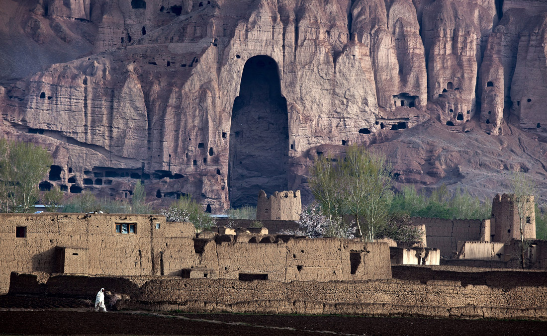 © GRAHAM CROUCH - 08.05.2012, The empty caves that once contained the largest free standing statues of Buddha still dominate the skyline of Bamiyan Afghanistan The statues were blown up by the Taliban in March 2001