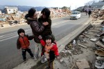 A joyful reunion between two friends on roadway amongst debris of destroyed homes as large parts of the Northern Coastal town of Ofunato were destroyed after a massive 9.0-magnitude earthquake caused a destructive tsunami which hit the eastern coast of Japan on 11/03/2011 causing widespread deaths and destruction.