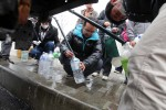 Locals at the town of Minanakata waiting for water after a 9.0 earthquake caused a tsunami which hit the eastern coast of Japan on the 14th March, 2011 © Kelly Barnes/TheAustralian