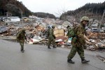 Japanese soliders walks thru debris in the Northern Coastal town of Rikuzentakata was destroyed after a 9.0 earthquake caused a tsunami which hit the eastern coast of Japan on the 11th March, 2011