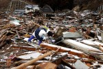 Taiko Sasaki searches for her aunt in the debris in the northern coastal town of Rikuzentakata that was destroyed after a 9.0-magnitude earthquake caused a tsunami which hit the eastern coast of Japan on the 11th March,2011  © Kelly Barnes/TheAustralian