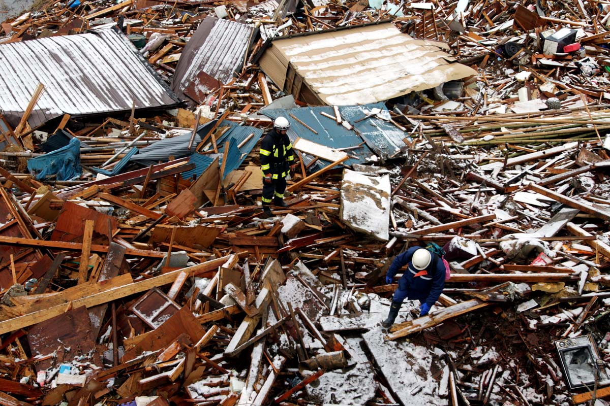 Rescue workers search the debris in the Northern Coastal town of Rikuzentakata was destroyed after a 9.0 earthquake caused a tsunami which hit the eastern coast of Japan on the 11th March, 2011   Kelly Barnes/TheAustralian