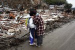 Taiko Sasaki comforts a neighbour in the northern coastal town of Rikuzentakata that was destroyed after a 9.0-magnitude earthquake caused a tsunami which hit the eastern coast of Japan on the 11th March, 2011 © Kelly Barnes/TheAustralian