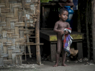 A PNG child at the family home on Hawaii Island, Manus Province - just a short boat ride from Lorengau. © Brian Cassey