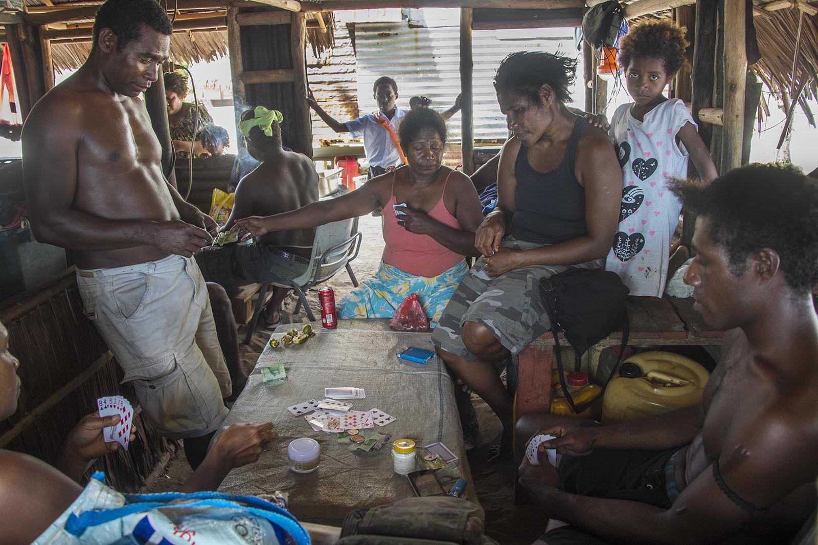 Residents of the village of Mokereng - just across the bay from the Lombrum refugee detention centre - pass the time playing cards. © Brian Cassey