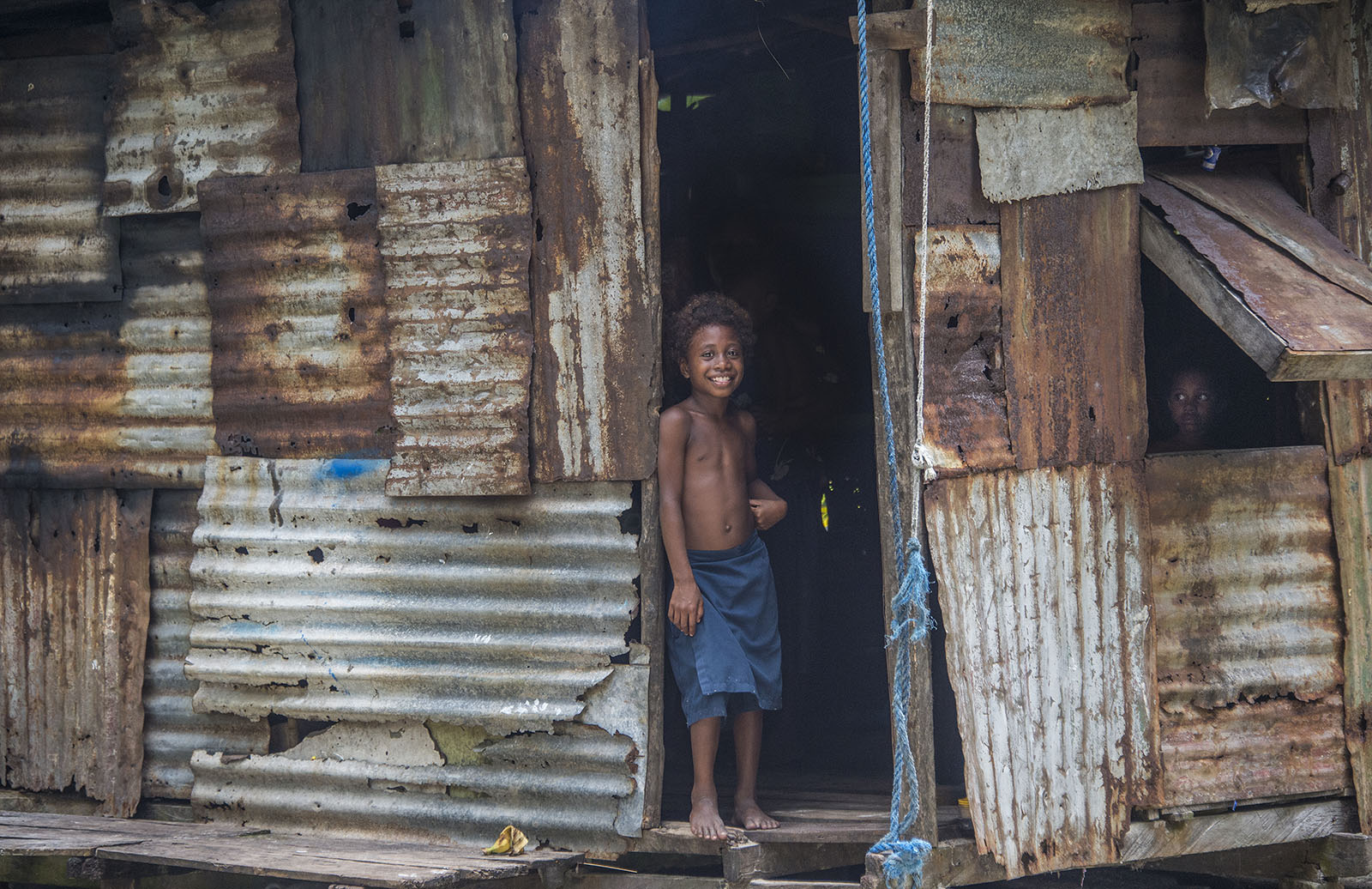 PNG boys at their family home on Hawaii Island, Manus Province - just a short boat ride from Lorengau. © Brian Cassey