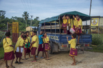 Manus Island children arrive for a days study at their school oiutside of Lorengau.© Brian Cassey