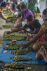 Women sell the natural carcinogenic beetle nut (known as buai) in the new central market built with Australian aid funds in Lorengau, Manus Island. © Brian Cassey
