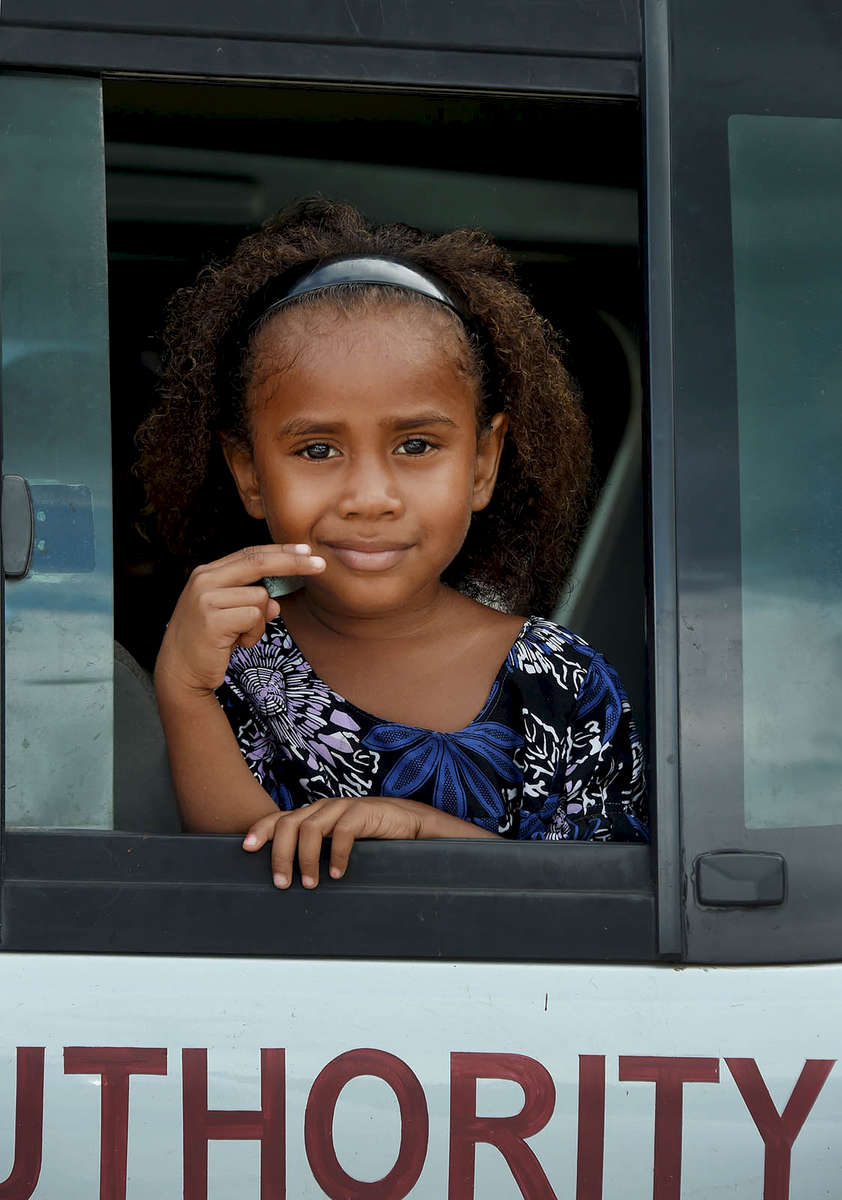 A young Manus girl on a local bus in Lorengau, Manus Island. © Brian Cassey