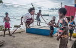 Children play at their house on the foreshore of Lorengau, Manus Island - PNG  © Brian Cassey
