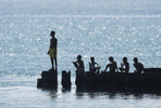 Local boys spend their time lazing on a wreck in Lorengau - the capitol of Manus Island PNG.© Brian Cassey