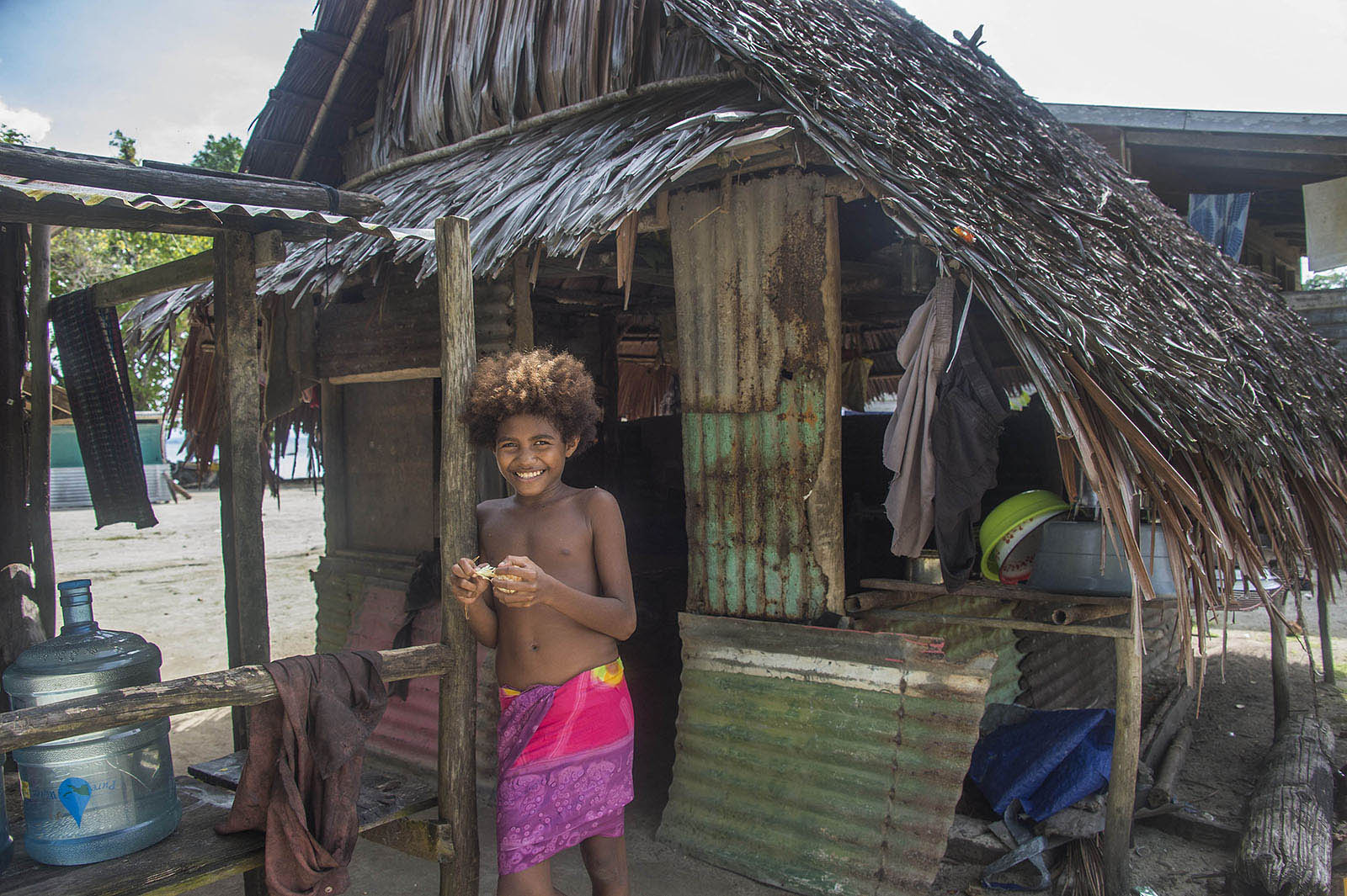 A young girl at home in the village of Mokereng - across the bay from the Australian Lombrum asylum seeker detention centre. © Brian Cassey