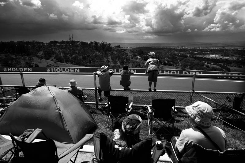 Mt Panorama, Bathurst, NSW. Fans surround the track, commonly known as {quote}The Hill{quote}  waiting for a glimpse of their favourite driver to fly past at speeds over 200 km/ph at Mt Panorama, Bathurst, NSW, Australia.
