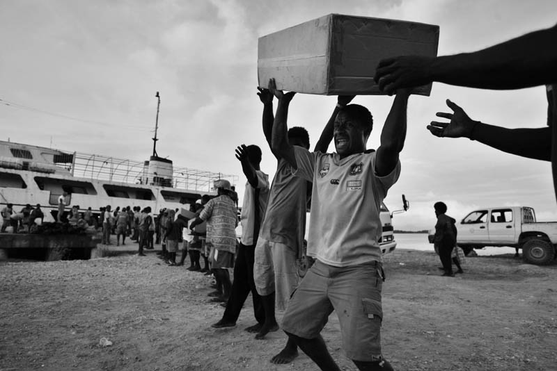 Aid arrives on the dock on the island of Gizo.© Sam Mooy 2007 for The Australian