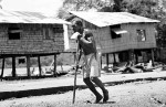 A man hobbles on a makeshift crutch.© Sam Mooy 2007 for The Australian